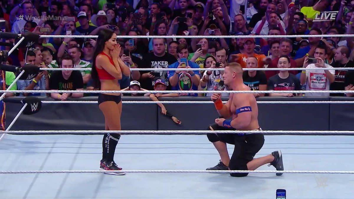 John Cena proposes to Nikki Bella.